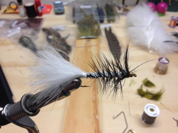 A white bugger with black hackle.